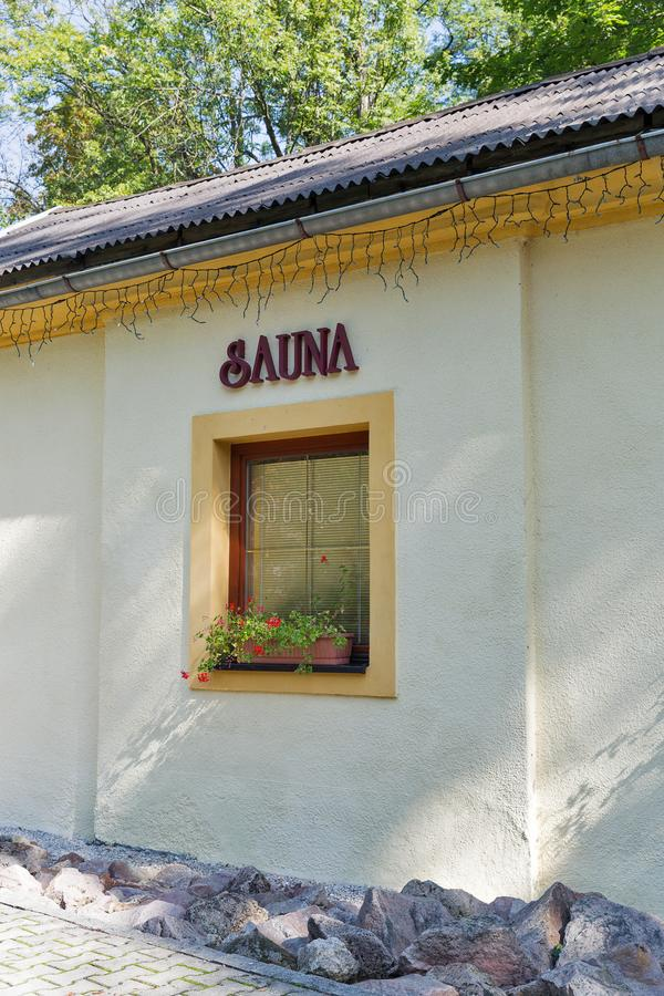 Sauna sign outdoor on building stock image