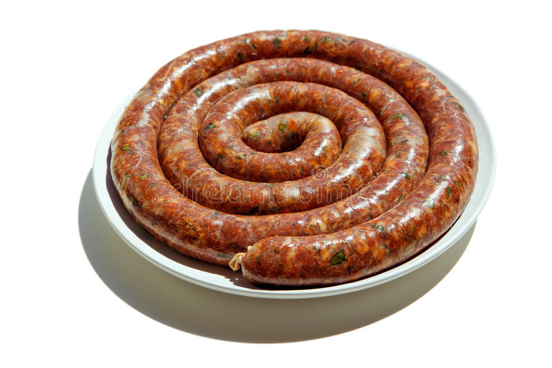 Sausage. Links of home made spicy Italian sausage with fresh herbs ready for BBQ stock photography