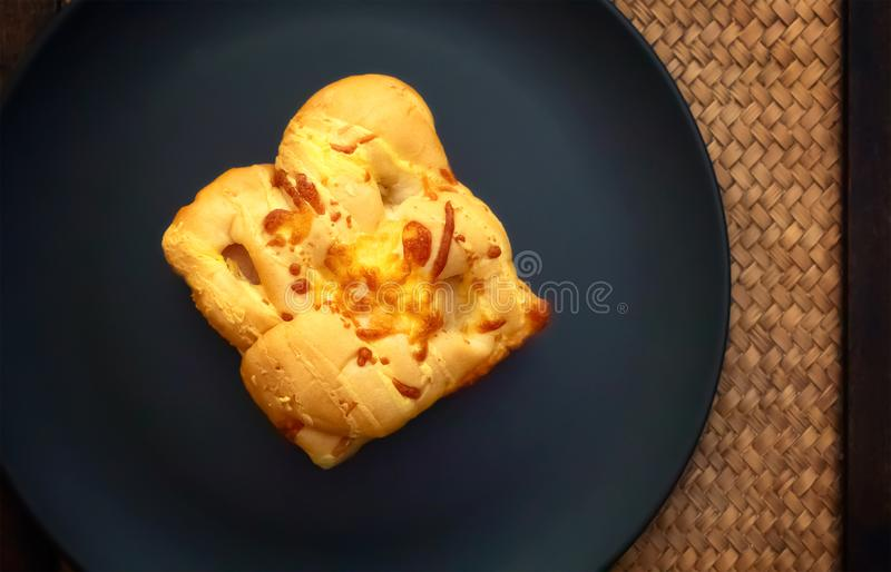 Sausage and Cheese Bread on a Dark Plate.  stock photos