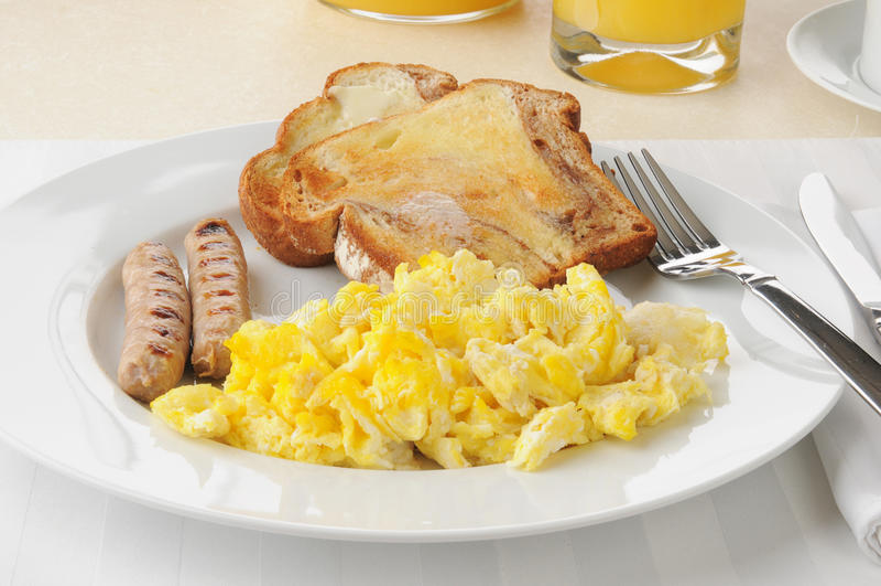 Sausage And Eggs With Cinnamon Toast Stock Image