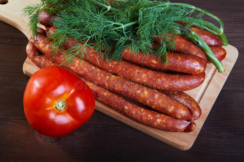 Download Sausage Fennel And A Tomato On An  Wooden Table Stock Image - Image: 25880391