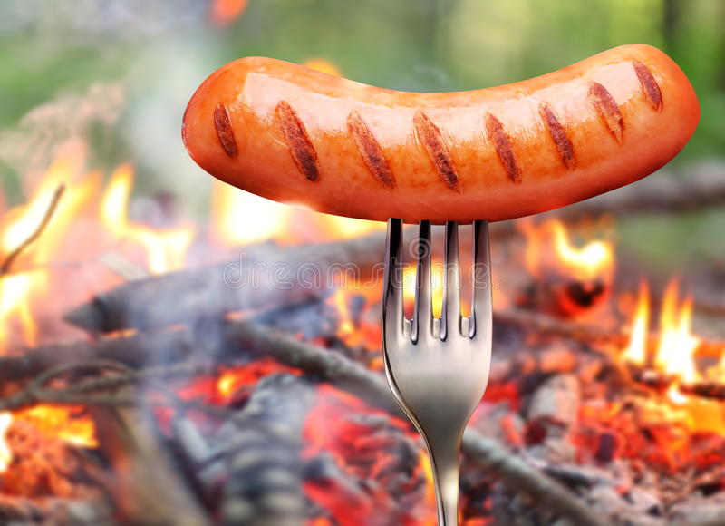 Download Sausage on a fork. stock photo. Image of snacks, outdoor - 26186130