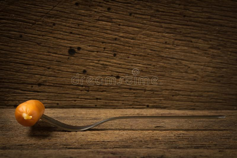 sausage on fork on old wood royalty free stock images