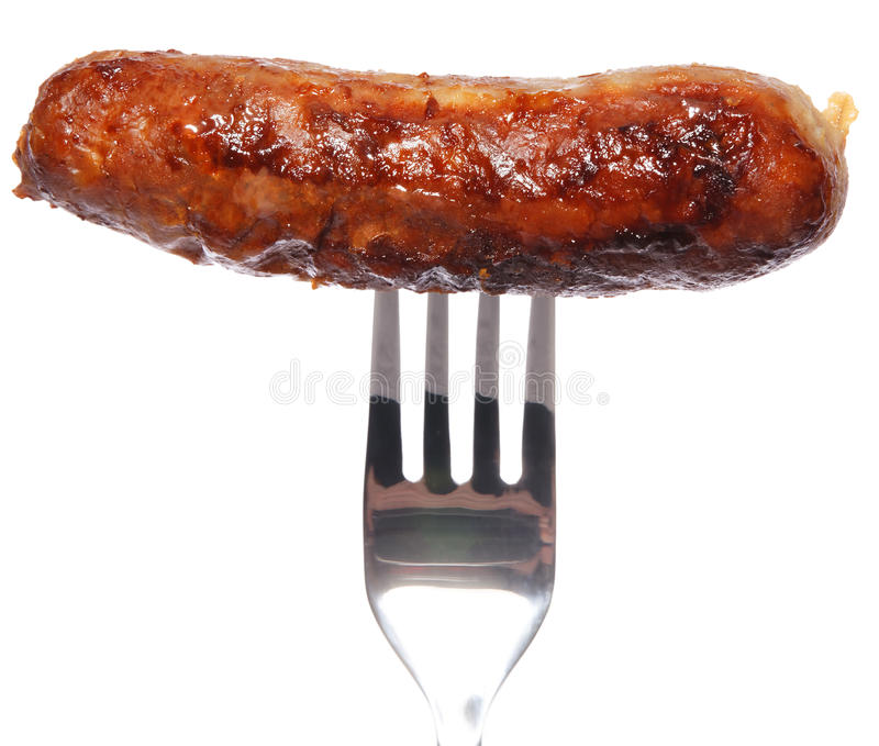 Sausage on fork. Punctured, White Background, fried stock images
