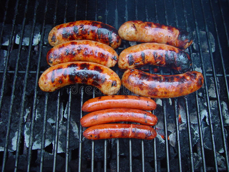 Sausage on the grill royalty free stock photos