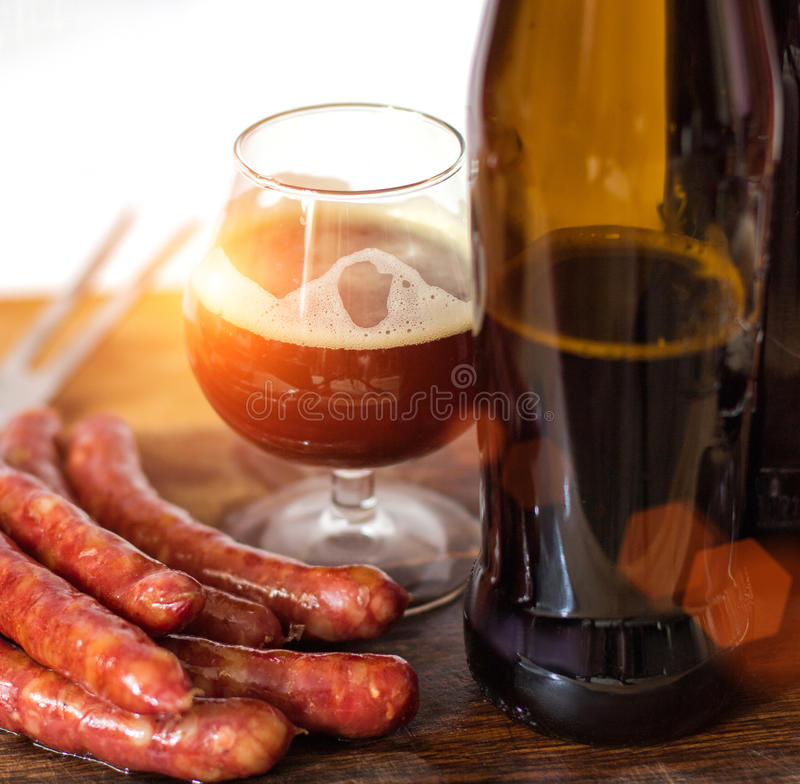 Sausage from the grill and beer. stock photos