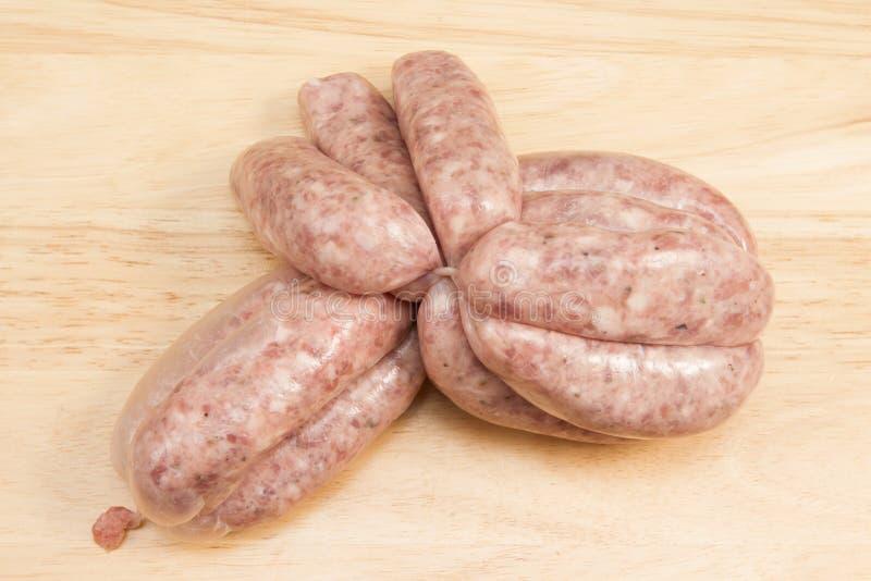 Sausage links. A link of twelve butchers sausages royalty free stock images