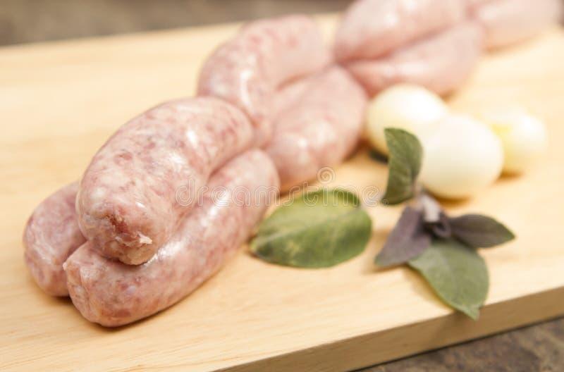Sausage links. A link of twelve butchers sausages stock image