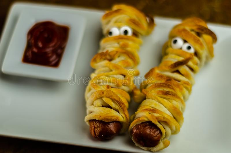 Sausage mummies in dough scary halloween food celebration party royalty free stock photo