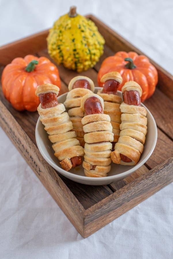 Sausage mummies in dough scary halloween food stock photos