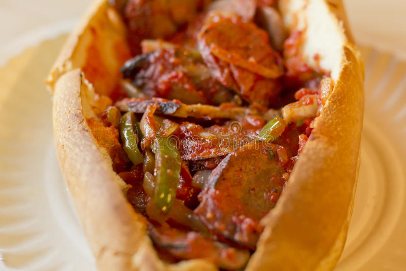 Sausage Onion Pepper Sandwich. Fried sausage onions and red and green bell peppers on sandwich bun royalty free stock image