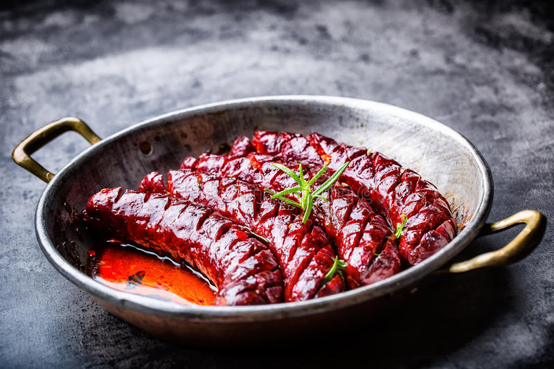 Sausage. Roasted chorizo sausage. Roasted spicy sausage chorizo home hotel or restaurant with beer vine brandy cognac whiskey. royalty free stock images