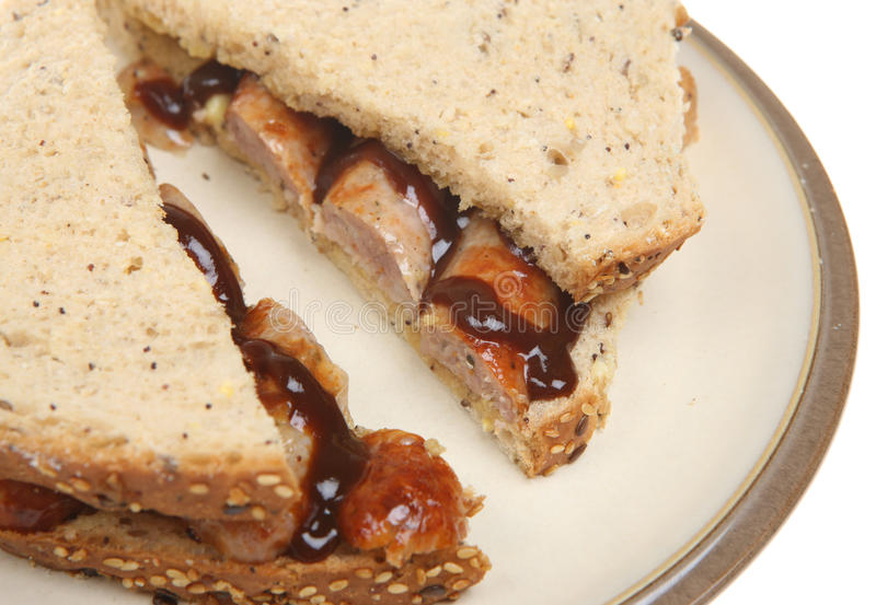 Sausage Sandwich with Brown Sauce stock photo