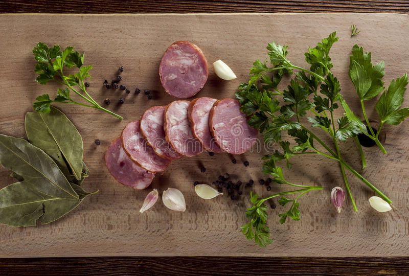 Sausage. Sliced sausage on a kitchen board stock photos