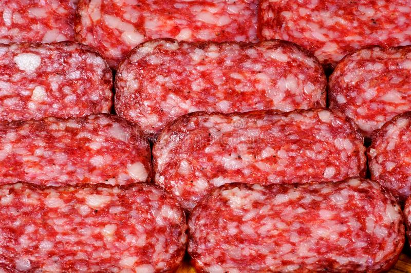 Sausage, sliced, tasty food, a popular snack. Sausage-a popular food product, minced meat in a shell. Contains one or more types stock images