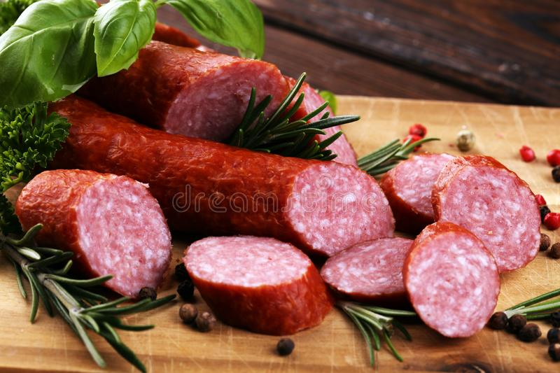 Sausage slices, smoked meat product tasty snack salami menu concept. food background with cracow sausages. Sausage slices, smoked meat product tasty snack salami stock image