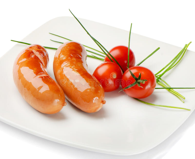 Sausage with tomatoes stock image