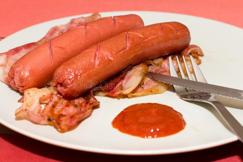Download Sausages With Bacon stock photo. Image of protein, ketchup - 24546980