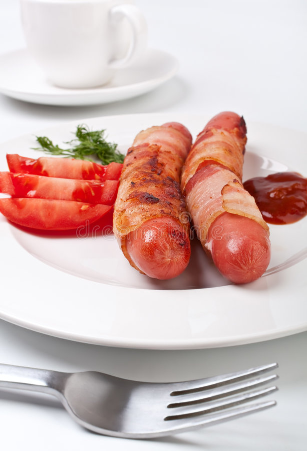 Sausages In Bacon, Coffee, Tomatoes Stock Images