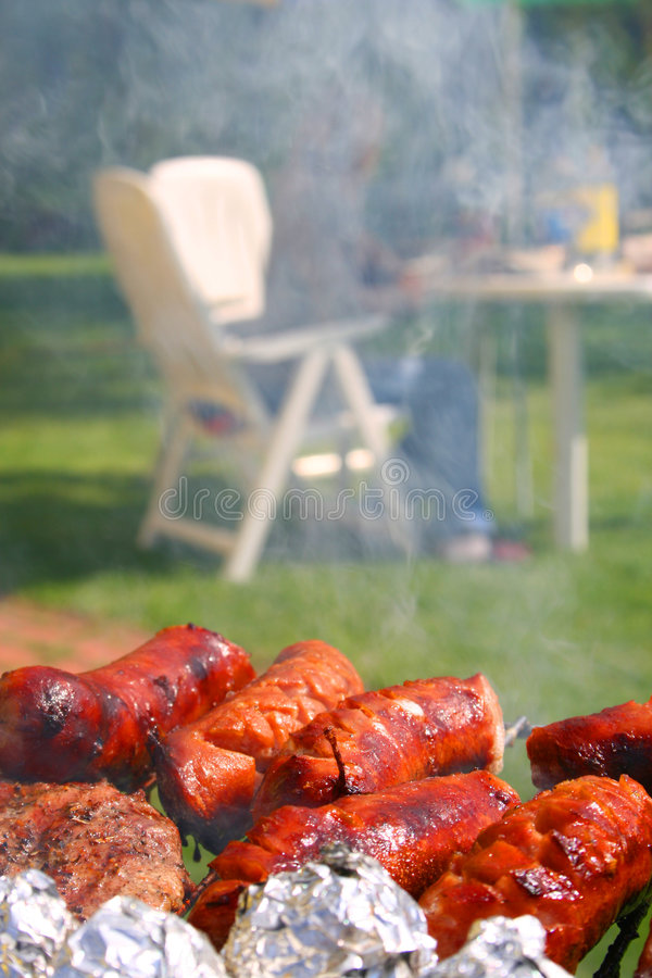 Sausages on a barbecue stock images