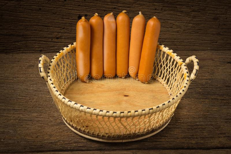 sausages in basket on old wood royalty free stock photography