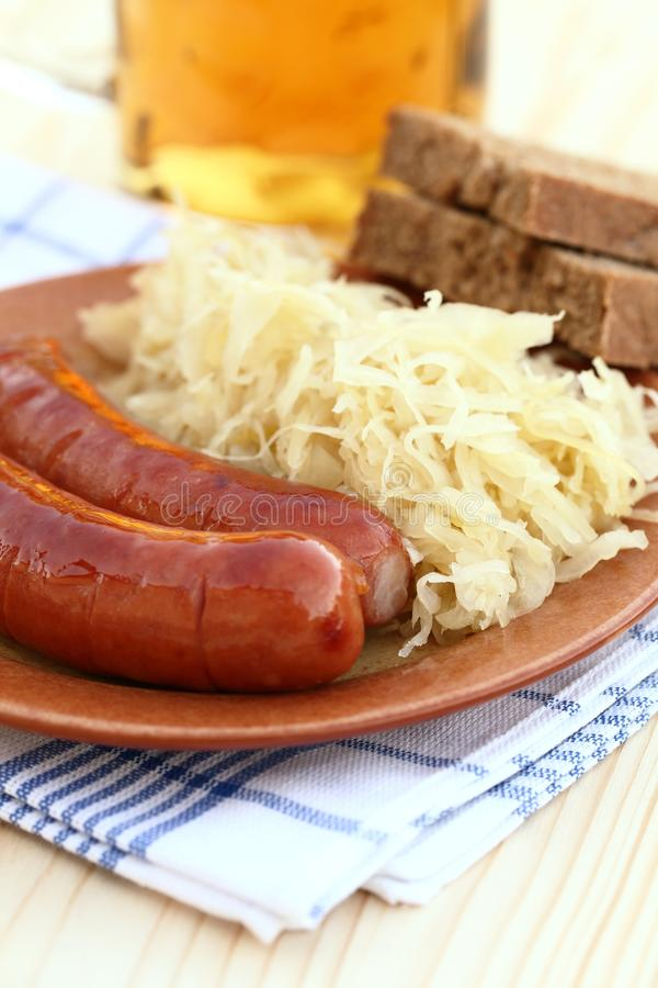 Sausages and cabbage stock image
