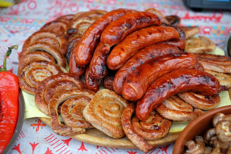 Sausages cooked on the grill during the food festival. royalty free stock image