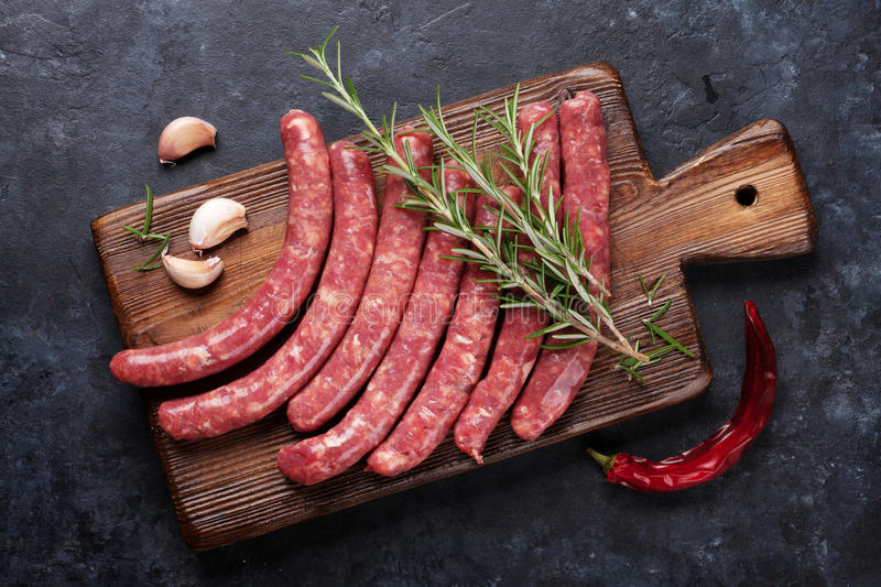 Sausages cooking stock photo