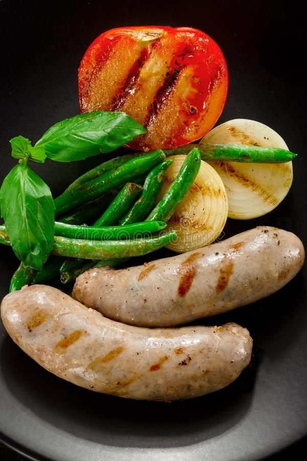 Download Sausages And Fried Tomatoes Stock Photo - Image: 27917822