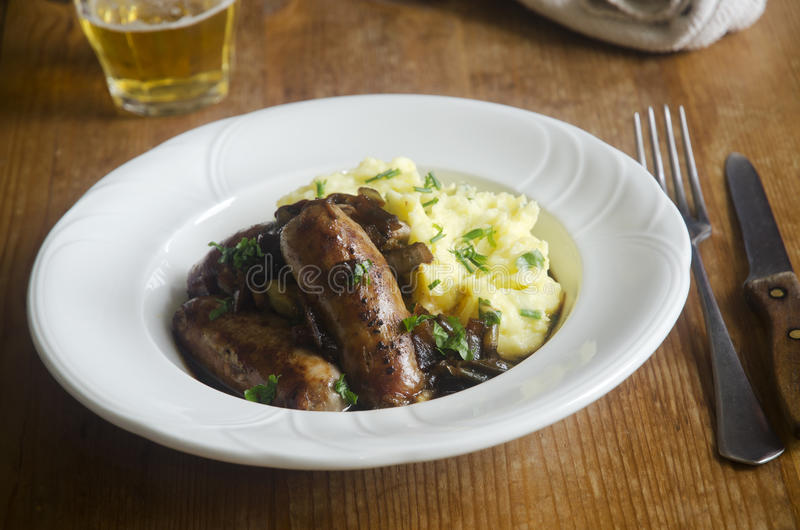Sausages with mash. Sausages with herby mash and onion gravy royalty free stock photography