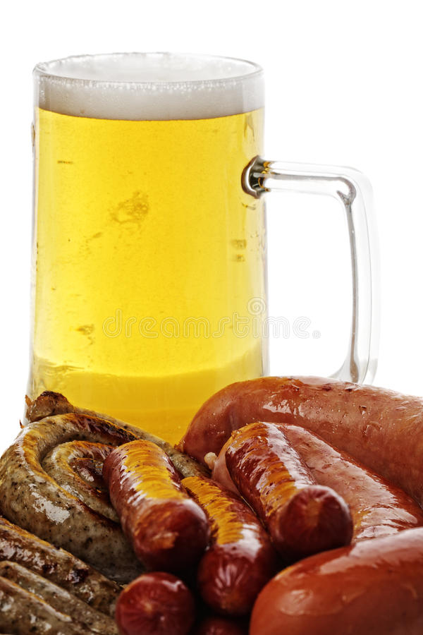 Sausages and mug of beer royalty free stock photos