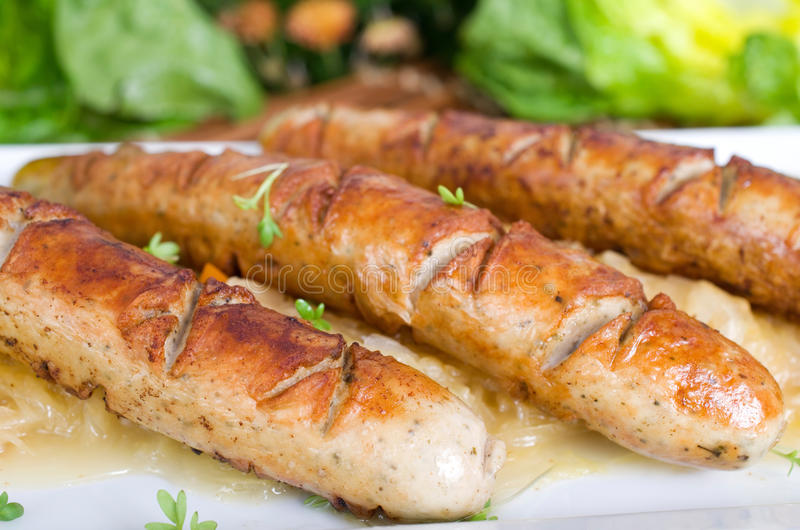 Sausages with pickled cabbage royalty free stock image