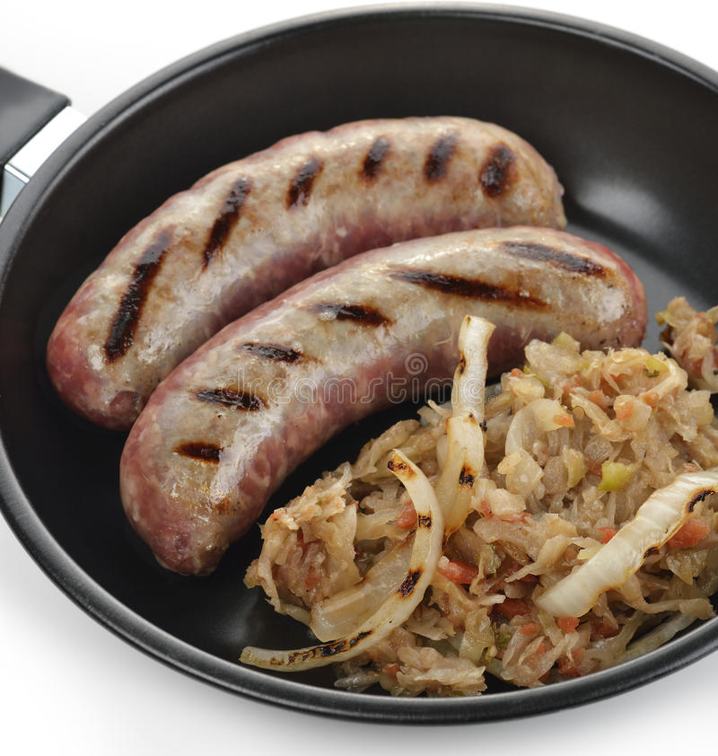 Download Sausages With Sauerkraut stock image. Image of frying - 27303837