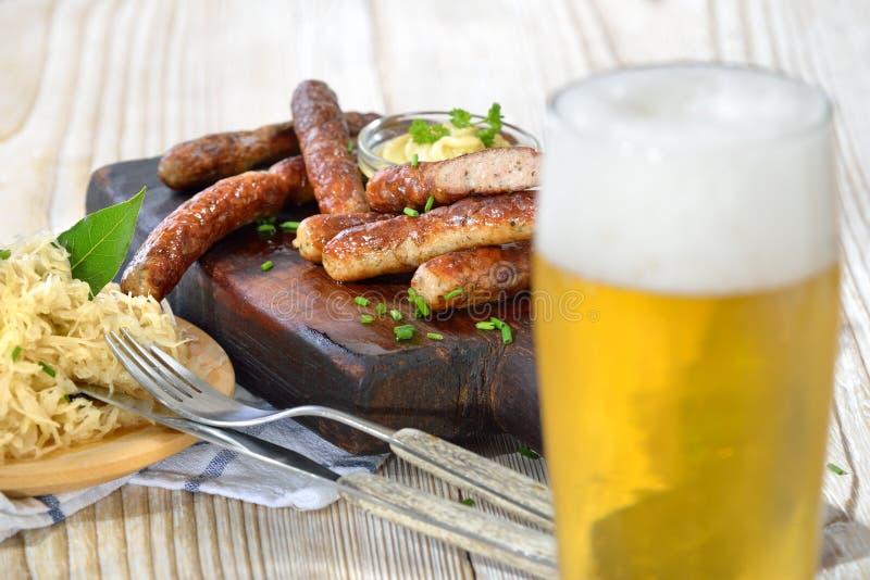 Sausages with sauerkraut and beer stock photos