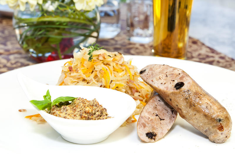 Sausages with sauerkraut and mustar royalty free stock photo
