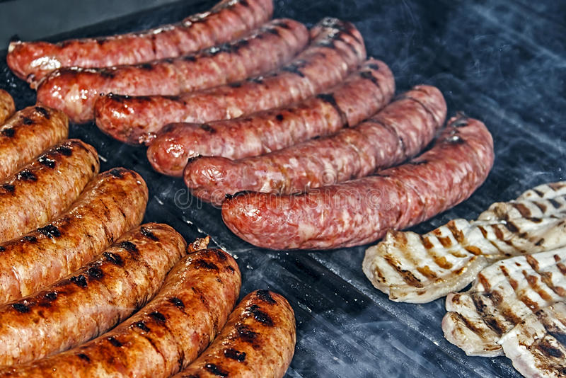 Sausages and steak on the grill