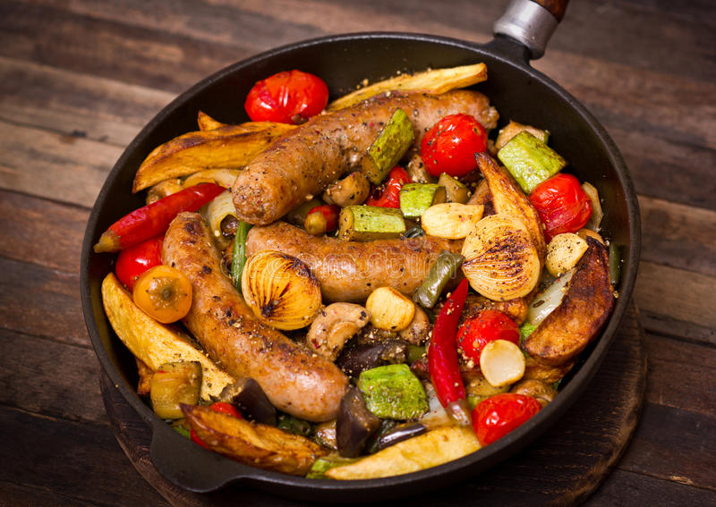 Sausages and vegetables royalty free stock image