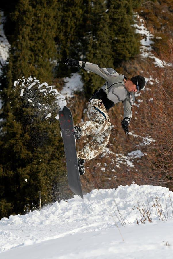 Saut extrême de Snowboarder image libre de droits