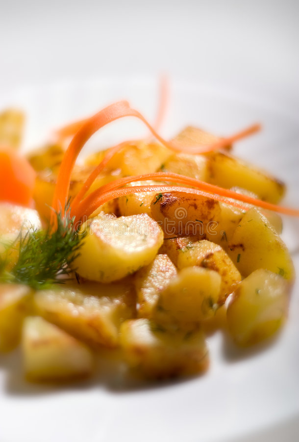 Saute potatoes. With wine sauce and finely dill stock photography