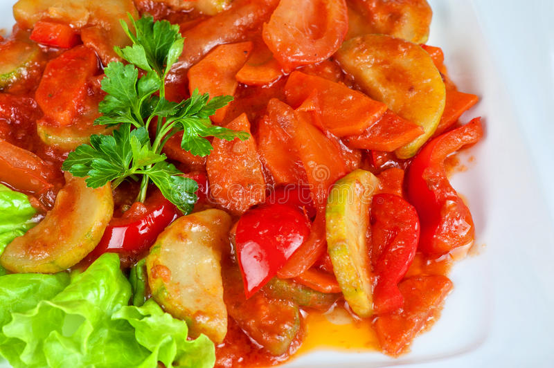 Saute from zucchini. Tomato, pepper and carrot royalty free stock photography