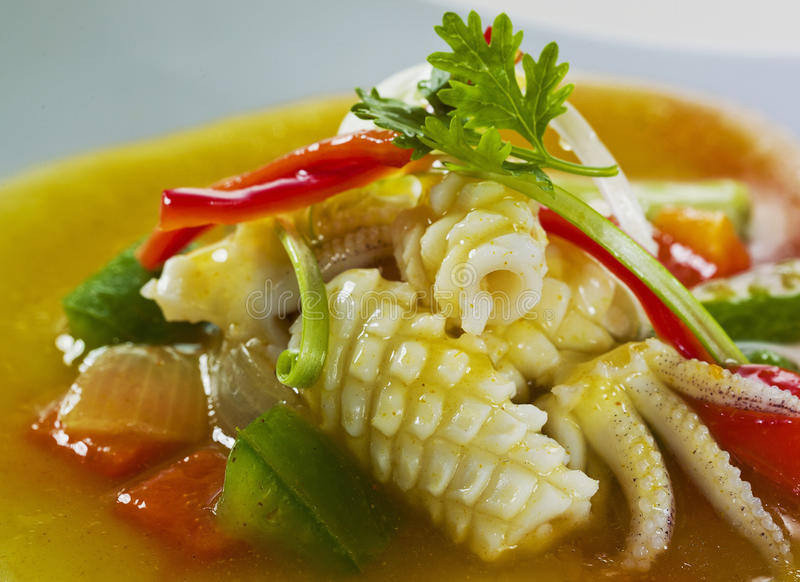 Sauteed Calamari with vegetable stock photography