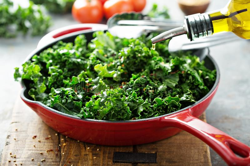 Sauteed kale with chili flakes royalty free stock image