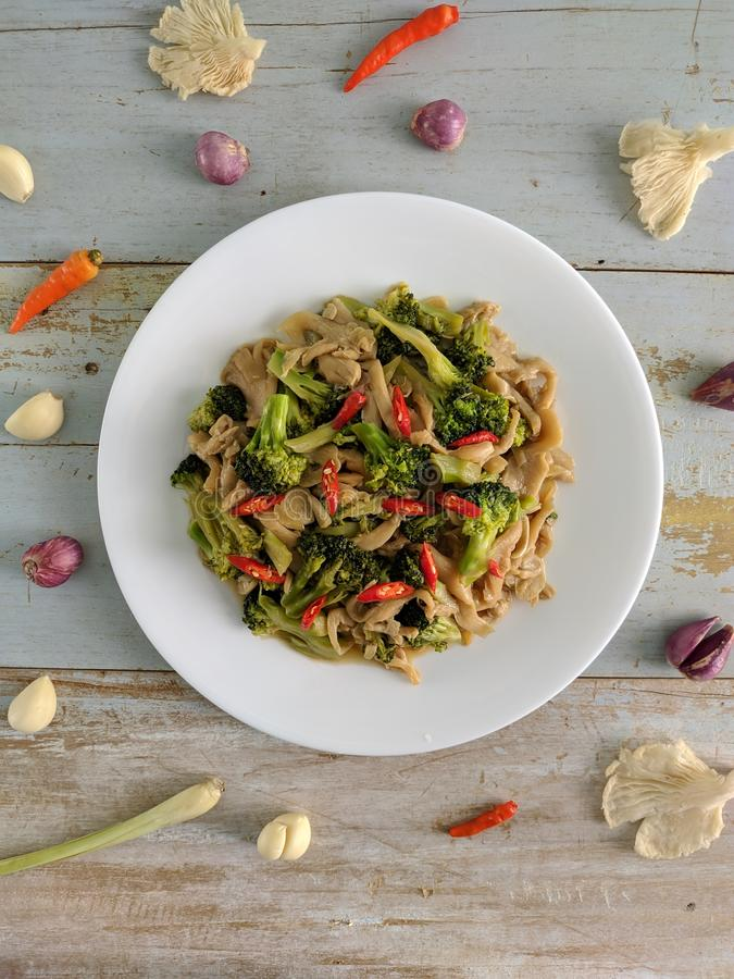 Sauteed mushrooms mixed with broccoli royalty free stock photo
