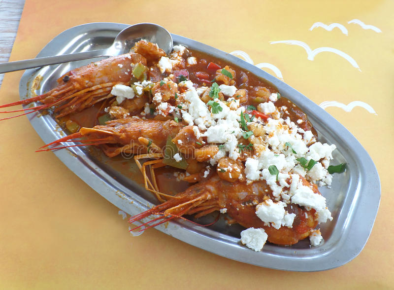 Sauteed Shrimp with Tomatoes, Olives and Feta Cheese, Greek Seafood at Mykonos Island. Top View of Sauteed Shrimp with Tomatoes, Olives and Feta Cheese, Greek royalty free stock photo