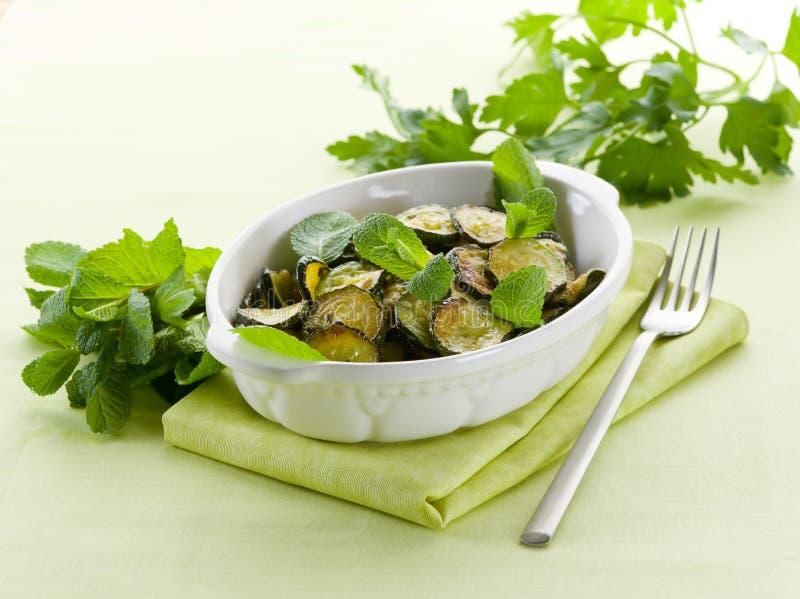 sauteed zucchinis стоковое изображение