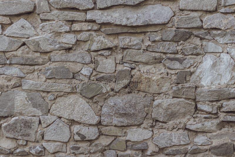 Sauvage d?corez la texture de mur en pierre fond sec de maison naturelle de fa?ade le vieux grunge bascule le r?tro papier peint  image libre de droits