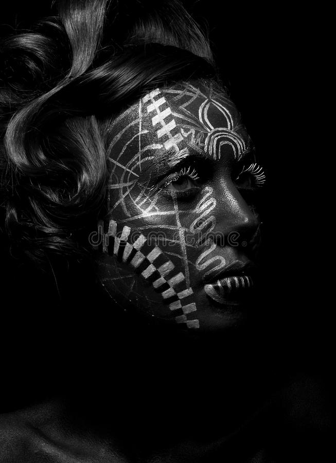 Savage religious woman voodoo, tattoo. Tribe. Savage religious woman voodoo with ornamental tattoo. Tribe person. Painted face royalty free stock photos
