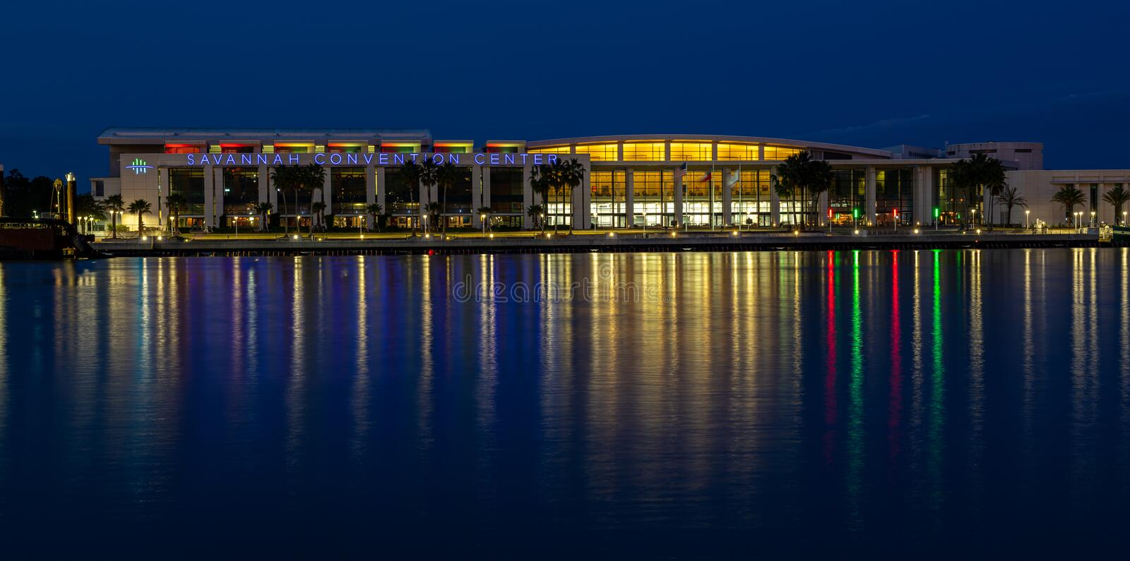 Savannah Convention Center lighting reflects on the Savannah River during blue hour. Across from River Street in the historic district of Savannah Georgia stock photography