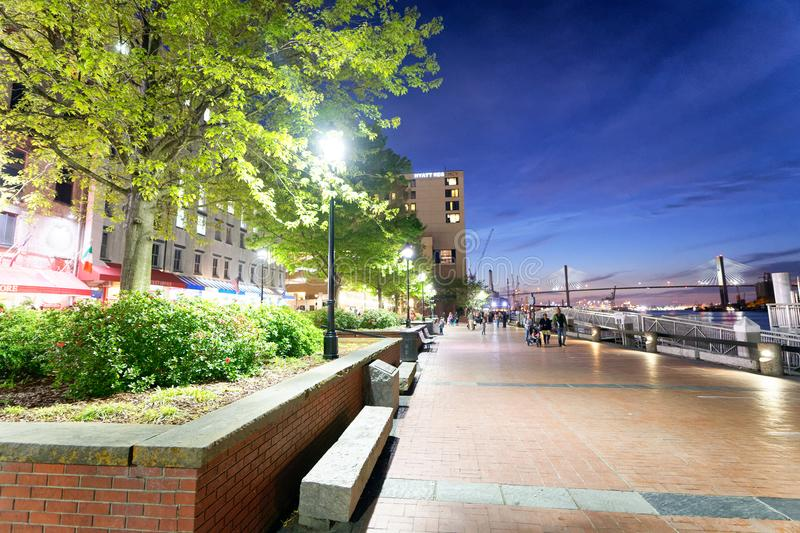 SAVANNAH, GA - APRIL 2, 2018: Tourists enjoy city streets at night. Savannah hosts 15 million tourists annually royalty free stock photo