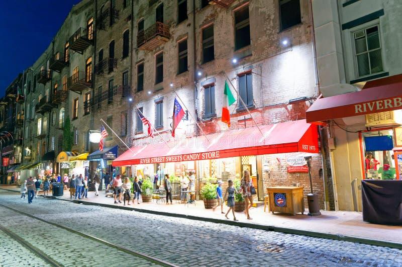 SAVANNAH, GA - APRIL 2, 2018: Tourists enjoy city streets at night. Savannah hosts 15 million tourists annually royalty free stock photography